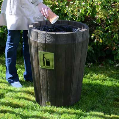 Sherwood Litter Bin in dark oak with an open top.